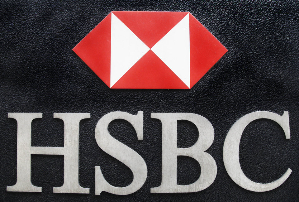 FILE - This May 11, 2012, file photo shows the corporate logo for HSBC hangs on a wall outside an office for the London-based multinational bank in New York. When the Justice Department announced its record $1.9 billion settlement against British bank HSBC last week, prosecutors called it a powerful blow to a dysfunctional institution accused of laundering money for Iran, Libya and Mexico's murderous drug cartels. But to some former federal prosecutors, it was only the latest case of the government stopping short of bringing criminal money laundering charges against a big bank or its executives. (AP Photo/Mark Lennihan, File)