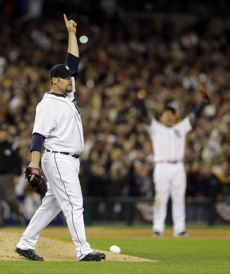 Photo -   Detroit Tigers' Phil Coke reacts to the final out against the New York Yankees at Game 4 of the American League championship series, Thursday, Oct. 18, 2012, in Detroit. The Tigers won 8-1 and move on to the World Series. (AP Photo/Paul Sancya )