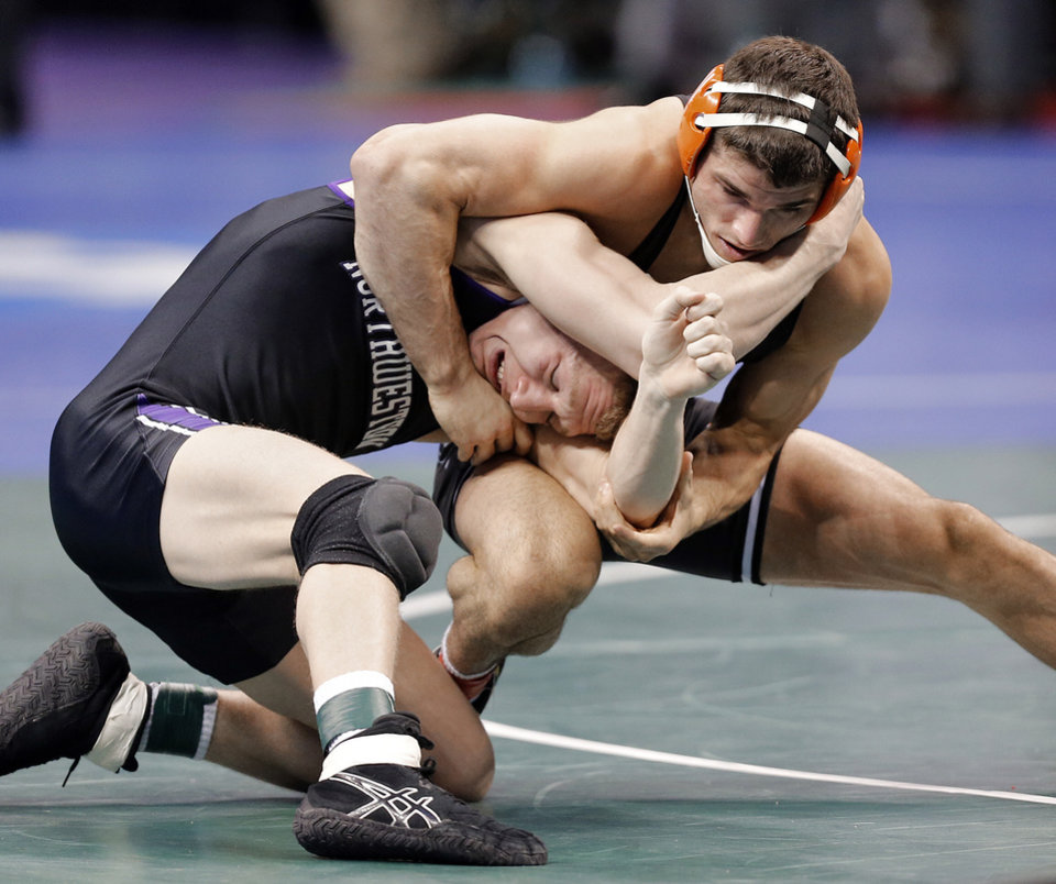 Photo - Oklahoma State's Tyler Caldwell takes on Northwestern's Pierce Harger in the 165 pound match during the 2014 NCAA Div. 1 Wrestling Championships at Chesapeake Energy Arena in Oklahoma City, Okla. on Friday, March 21, 2014. Photo by Chris Landsberger, The Oklahoman