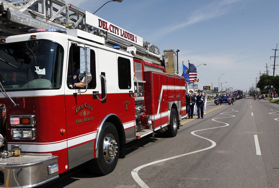 A Del City  firetruck leads the parade, followed by a military color guard. Del City and eastern Oklahoma County residents lined S. Sunnylane Road  to show their support for America's military,  applauding and cheering  participants who marched and rode in the city's Armed Forces Day Parade on Saturday morning, May, 19, 2012. The parade worked its way along the Del City route for a little more than an hour.  Photo by Jim Beckel, The Oklahoman