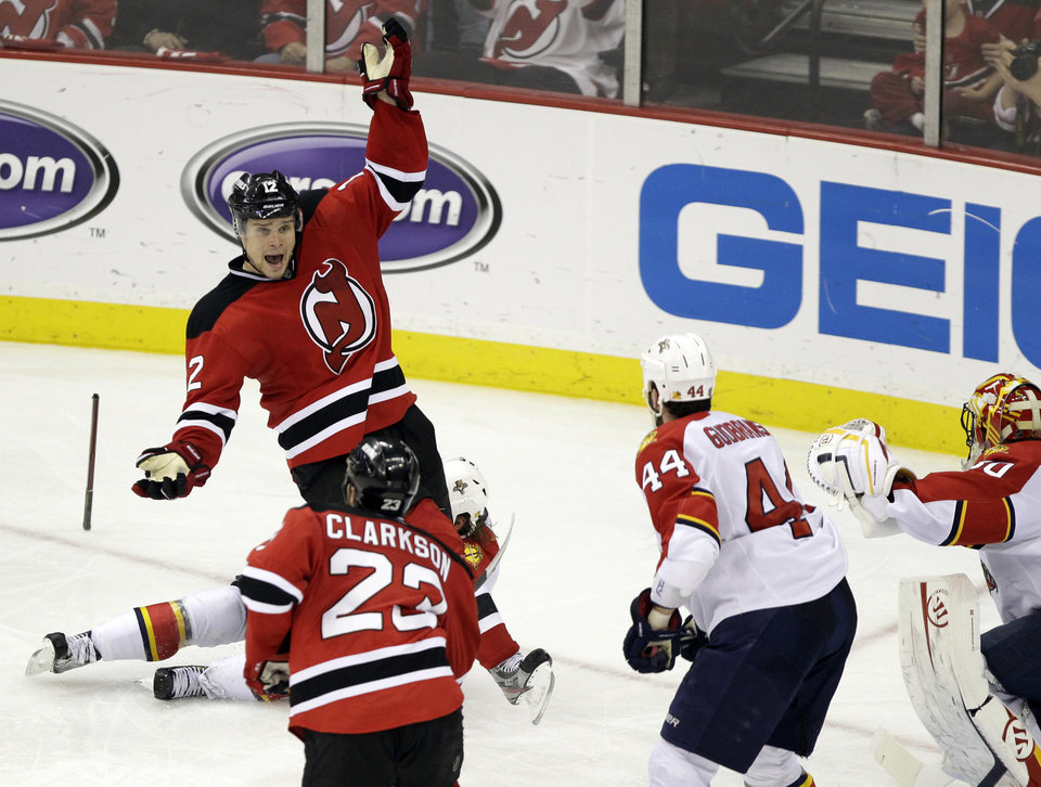 Photo -   New Jersey Devils' Alexei Ponikarovsky, of Ukraine, gestures after breaking his stick while competing for the puck with Florida Panthers' Stephen Weiss, on ice, during the third period of Game 6 of a first-round NHL hockey Stanley Cup playoff series, Tuesday, April 24, 2012, in Newark, N.J. (AP Photo/Julio Cortez)