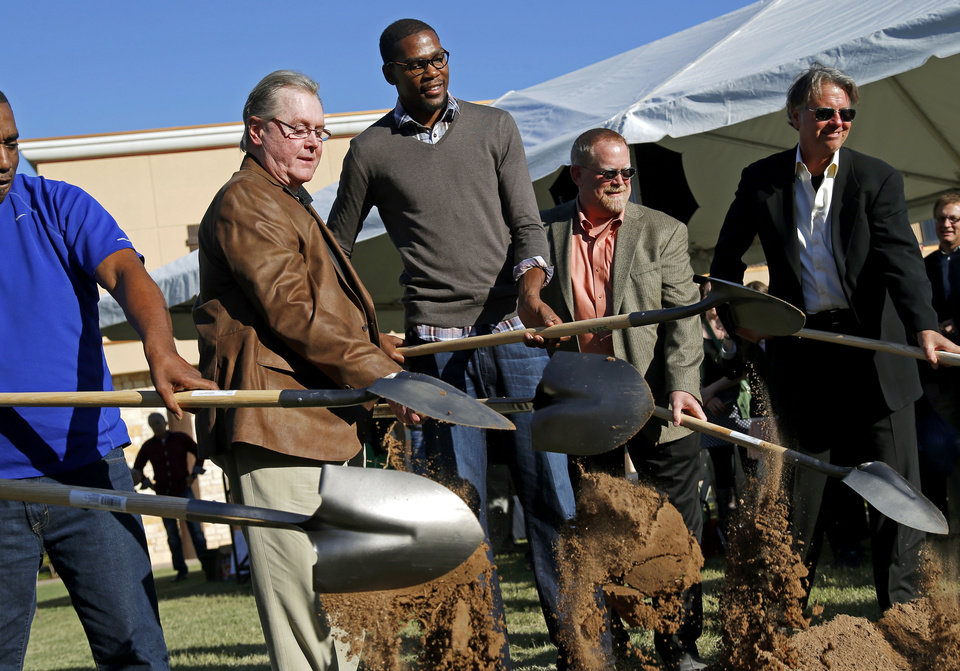 From left, Hal Smith, Kevin Durant, Dave Zimmer, and Randy Hogan break ground for Kevin Durant's new restaurant venture, KD's, in Oklahoma City's Bricktown district, Tuesday, October 30, 2012. Photo by Bryan Terry, The Oklahoman