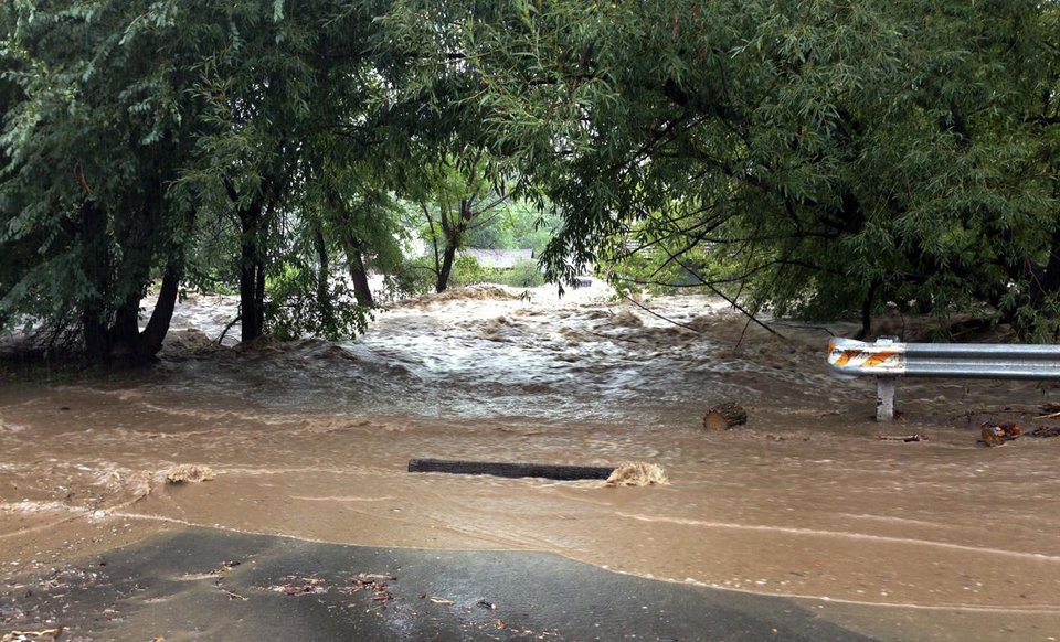 Photo - This image provided by Jason Stillman, shows flooding in Lyons Colo., Thursday Sept. 12, 2013. Boulder County Sheriff Joe Pelle said the town of Lyons was completely cut off because of flooded roads. Flash flooding in Colorado has cut off access to towns, closed the University of Colorado in Boulder and left at least three people dead. (AP Photo/Jason Stillman)