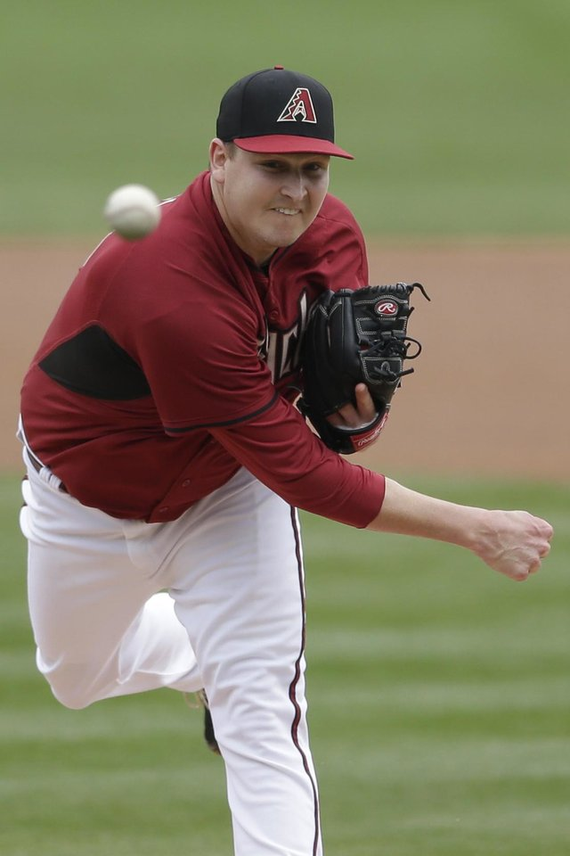 Photo - Arizona Diamondbacks starting pitcher Trevor Cahill pitches to an Oakland Athletics batter during the first inning of an exhibition spring training baseball game Thursday, March 6, 2014, in Scottsdale, Ariz. (AP Photo/Gregory Bull)