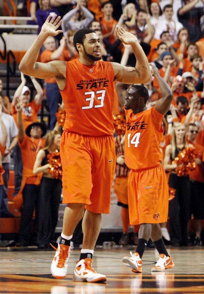 Photo - OSU's Marshall Moses (33) and Ray Penn (14) celebrate during the men's college basketball game between Oklahoma State University (OSU) and Kansas State University (KSU) at Gallagher-Iba Arena in Stillwater, Okla., Saturday, January 8, 2011. OSU won, 76-62. Photo by Nate Billings, The Oklahoman