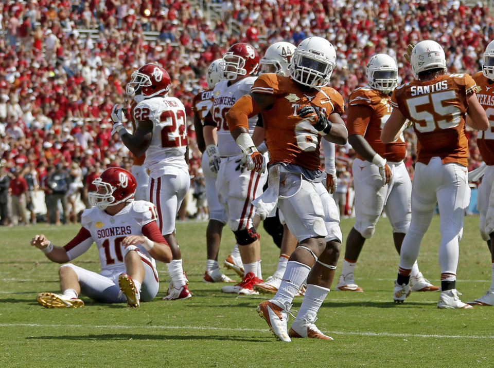 UT\'s Quandre Diggs (6) celebrates as OU\'s Blake Bell (10) gets up off the ground during the Red River Rivalry college football game between the University of Oklahoma Sooners and the University of Texas Longhorns at the Cotton Bowl Stadium in Dallas, Saturday, Oct. 12, 2013. Texas won 36-20. Photo by Bryan Terry, The Oklahoman