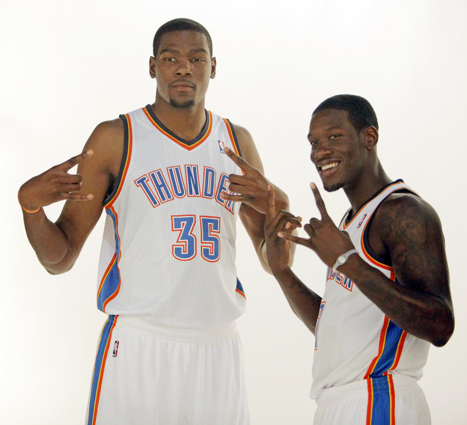 "Photo - Former Texas players Kevin Durant, left, and Royal Ivey give the ""hook 'em horns"" sign while posing for photos during media day for the Oklahoma City Thunder at the Ford Center in downtown Oklahoma City, Monday, Sept. 27, 2010. Photo by Nate Billings, The Oklahoman ORG XMIT: KOD"
