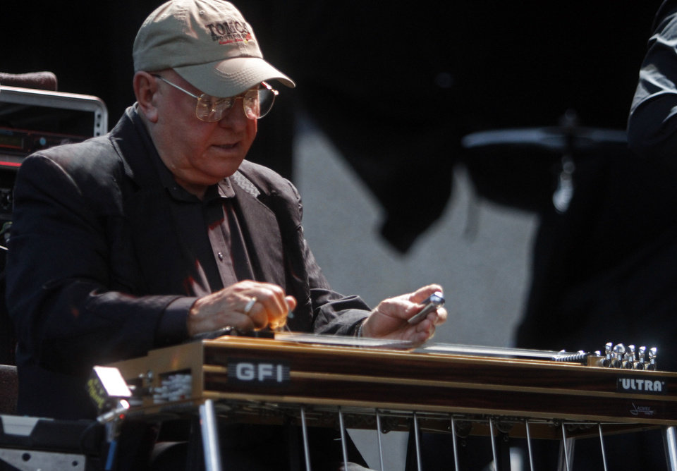 Photo - Steel guitar player Norm Hamlet plays a song as part of Merle Haggard's touring band that performed at OKC Fest in downtown Oklahoma City on Friday, June 27, 2014. OKC Fest is a new two day country music festival with multiple stages downtown. Photos by KT King/The Oklahoman
