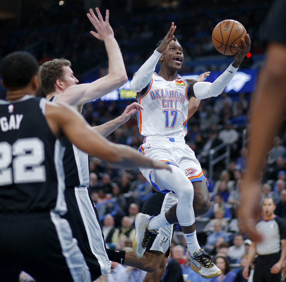 Photo - Oklahoma City's Dennis Schroder (17) goes to the baslet during an NBA basketball game between the Oklahoma City Thunder and the San Antonio Spurs at Chesapeake Energy Arena in Oklahoma City, Tuesday, Feb. 11, 2020. [Bryan Terry/The Oklahoman]