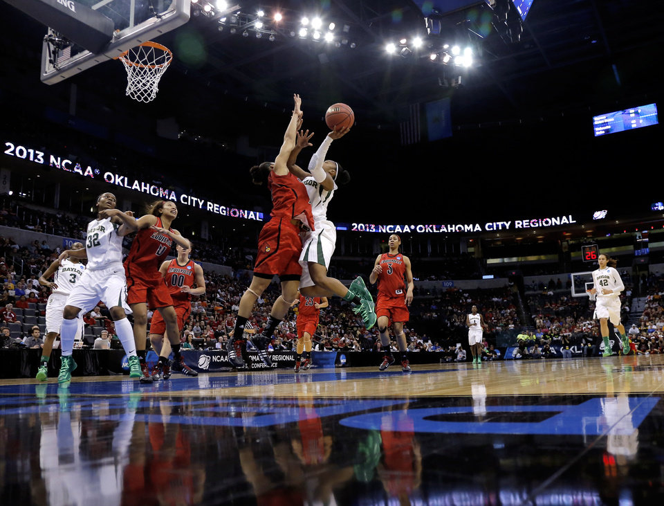 Baylor's Odyssey Sims (0) shoots as Louisville's Bria Smith (21) defends during college basketball game between Baylor University and the Louisville at the Oklahoma City Regional for the NCAA women's college basketball tournament at Chesapeake Energy Arena in Oklahoma City, Sunday, March 31, 2013. Photo by Sarah Phipps, The Oklahoman