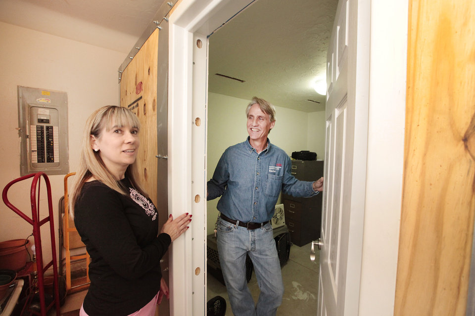 Photo - Rita Chandler looks over her Kevlar above-ground shelter with Philip Slater, owner of Oklahoma Storm Rooms, at her home in northwest Oklahoma City.  Photo s by David McDaniel, The Oklahoman  David McDaniel -
