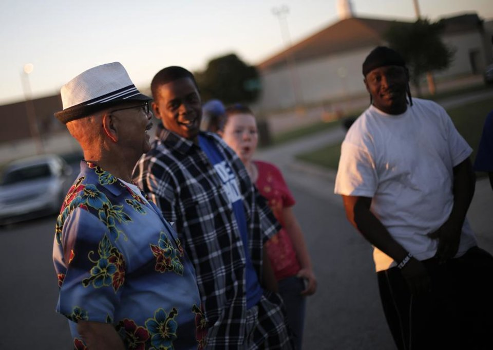Osei Bandele (left), Vice President of the JFK Neighborhood Association, talks with neighborhood residents during a National Night Out event at the JFK Neighborhood in Oklahoma City, Tuesday, Sept. 11, 2012.  Photo by Garett Fisbeck, The Oklahoman