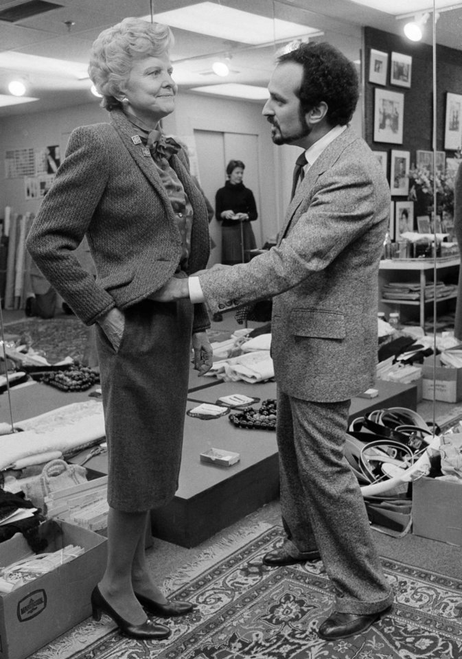 Photo - FILE - This Feb. 4, 1981 file photo shows former first lady Betty Ford getting outfitted with a spring wardrobe by Seventh Avenue designer Albert Capraro, in New York. She is wearing a cranberry tweed wool jacket with a silk blouse and flat wool skirt. Sure, living in the White House has its perks, but a clothing allowance is not one of them. First ladies feel all sorts of pressure to project a fashionable look, and over the decades they've tried a range of cash-saving strategies to pull it off without going broke. Mrs. Ford purchased clothing from Capraro to minimize the costs of her wardrobe. (AP Photo/Dave Pickoff, File)