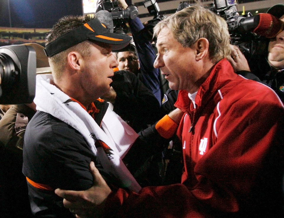 Photo - OSU head coach Mike Gundy, left, and Indiana head coach Bill Lynch speak after the Insight Bowl college football game between Oklahoma State University (OSU) and the Indiana University Hoosiers (IU) at Sun Devil Stadium on Monday, Dec. 31, 2007, in Tempe, Ariz. OSu won, 49-33. BY NATE BILLINGS, THE OKLAHOMAN