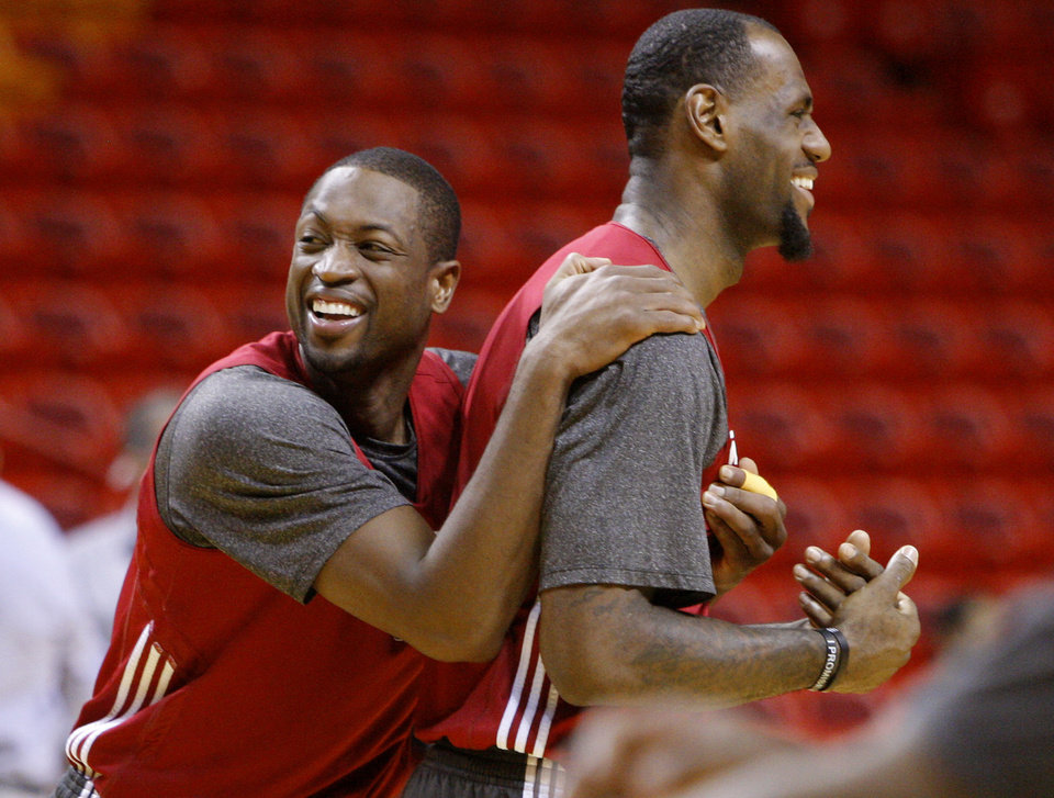Photo - Miami's Dwyane Wade, left, and LeBron James joke around during a practice for Game 5 of the NBA Finals between the Oklahoma City Thunder and the Miami Heat at American Airlines Arena, Wednesday, June 20, 2012. Photo by Bryan Terry, The Oklahoman