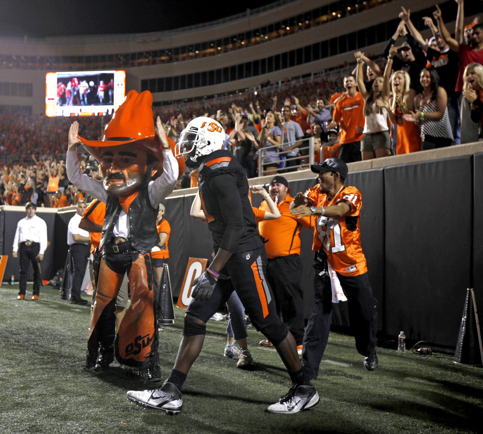 Oklahoma State's Justin Blackmon celebrates after a touchdown during the Cowboys 37-14 win over Arizona on Thursday in Stillwater. PHOTO BY BRYAN TERRY, The Oklahoman