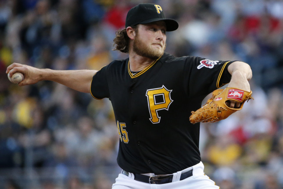 Photo - Pittsburgh Pirates starting pitcher Gerrit Cole delivers during the first inning of a baseball game against the Washington Nationals in Pittsburgh, Saturday, May 24, 2014. (AP Photo/Gene J. Puskar)