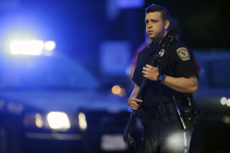 A police officer stands guard at the scene as the search for suspect in the Boston Marathon bombings continues , Friday, April 19, 2013, in Watertown, Mass. Gunfire erupted Friday night amid the manhunt for the surviving suspect in the Boston Marathon bombing, and police in armored vehicles and tactical gear rushed into the Watertown neighborhood in a possible break in the case. (AP Photo/Matt Rourke) ORG XMIT: MAMR147