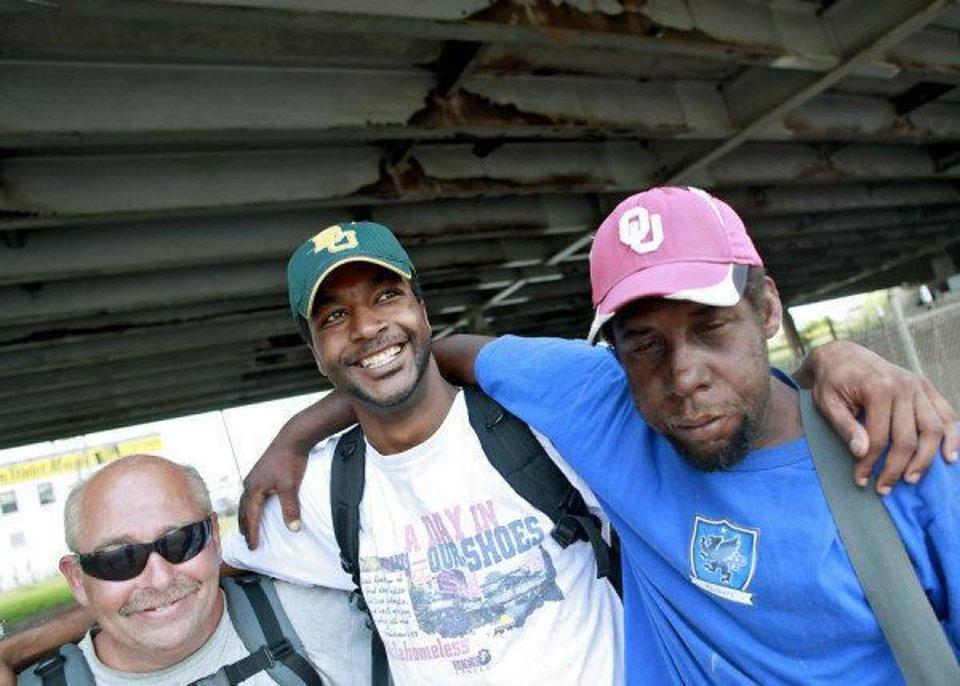 "Antwone Taulton, center, poses with  Terry Potts, left, and Ralph ""Scooby"" Crumble, two of the subjects in his new documentary film, in downtown Oklahoma City. PHOTO BY JOHN CLANTON, THE OKLAHOMAN <strong>JOHN CLANTON - JOHN CLANTON</strong>"