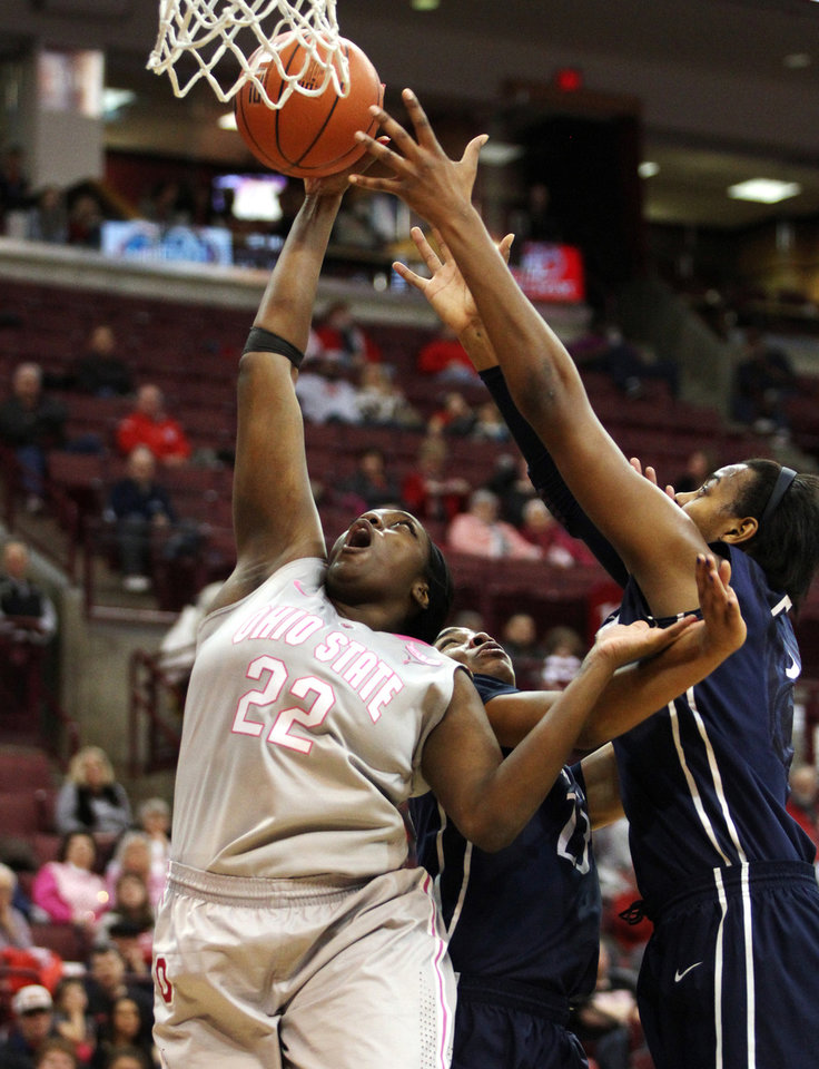 Photo - Ohio State's Darryce Moore (22) goes for a rebound against Penn State during the second half of an NCAA women's  college basketball game, Sunday, Feb. 9, 2014, in Columbus, Ohio. Penn State won 74-54. (AP Photo/Mike Munden)
