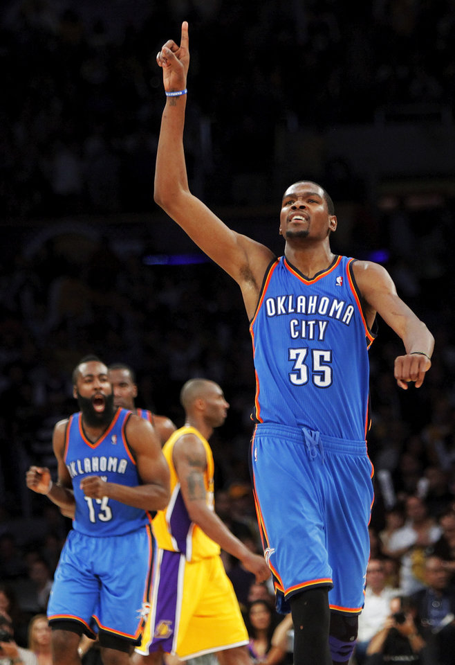 Oklahoma City\'s Kevin Durant (35) reacts after James Harden (13), left in front of Los Angeles\' Kobe Bryant (24), hit a pair of foul shots with 7.3 seconds left in the fourth quarter during Game 4 in the second round of the NBA basketball playoffs between the L.A. Lakers and the Oklahoma City Thunder at the Staples Center in Los Angeles, Saturday, May 19, 2012. Oklahoma City won, 103-100. Photo by Nate Billings, The Oklahoman