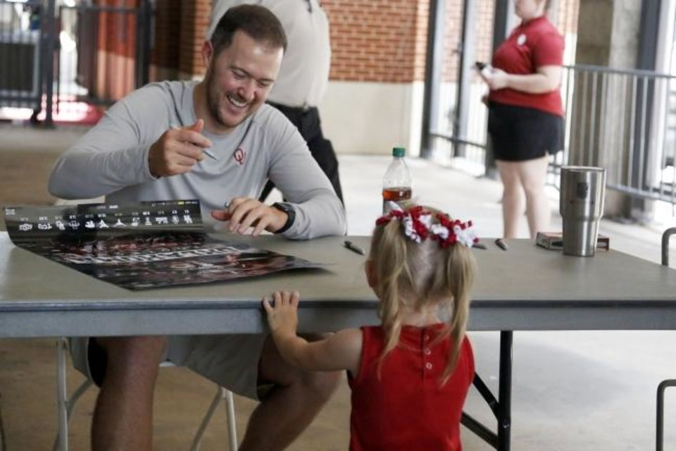 Photo -  Oklahoma coach Lincoln Riley smiles as he signs autographs at Meet the Sooners Day at Gaylord Family — Oklahoma Memorial Stadium on Friday in Norman. [Paxson Haws/The Oklahoman]