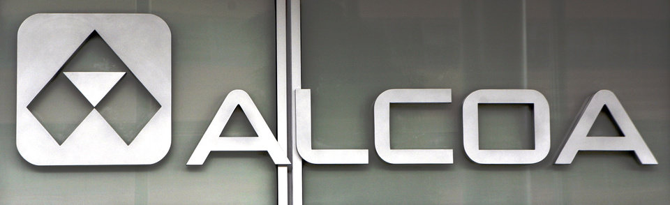Photo -   This April 9, 2011 photo, shows the Alcoa headquarters building logo in downtown Pittsburgh. Aluminum manufacturer Alcoa Inc. says Tuesday, Oct. 9, 2012, it lost $143 million in the third quarter due to charges, but otherwise topped Wall Street's expectations. Alcoa said Tuesday that the loss amounted to 13 cents per share. That compares with net income of $172 million, or 15 cents a share, a year ago. (AP Photo/Gene J. Puskar)