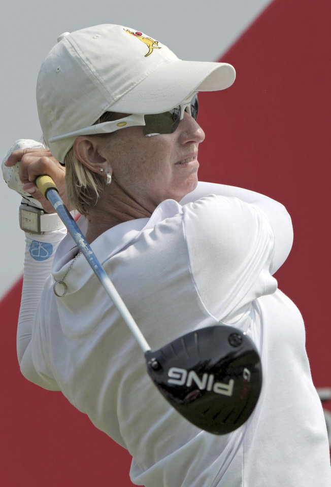 Photo - Karrie Webb of Australia tees off on the third hole as she plays in the final round of the HSBC Women's Champions golf tournament in Singapore, Sunday, Mar. 2, 2014. (AP Photo/Joseph Nair)