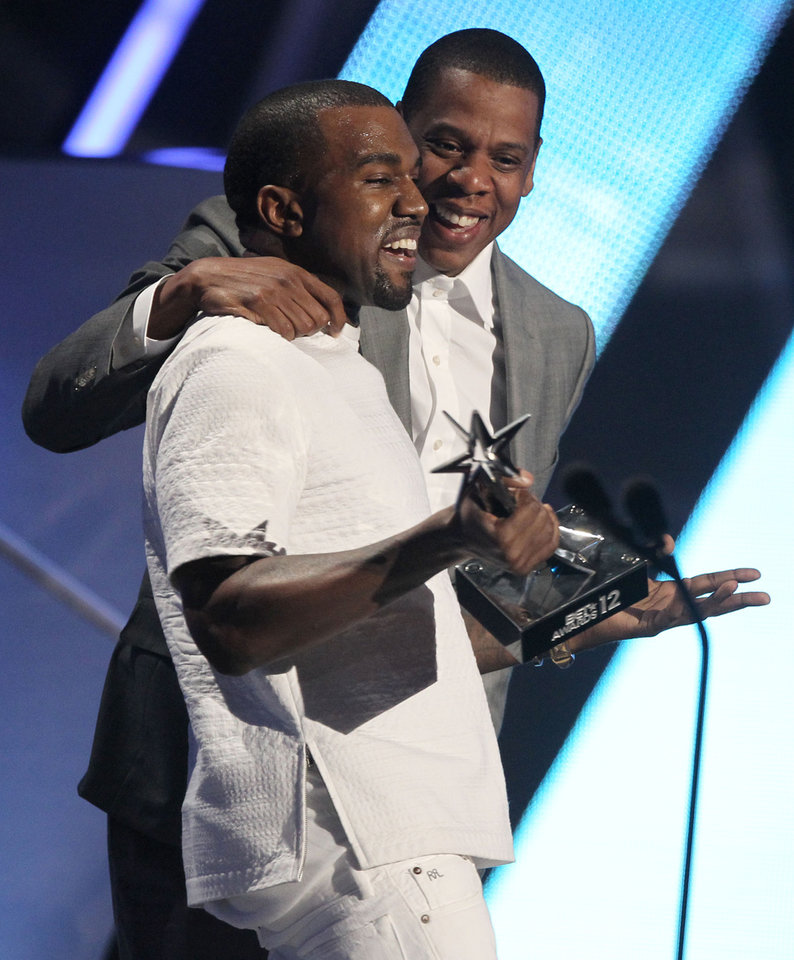 Photo -   Kanye West, left, and Jay-Z accept the award for best group for