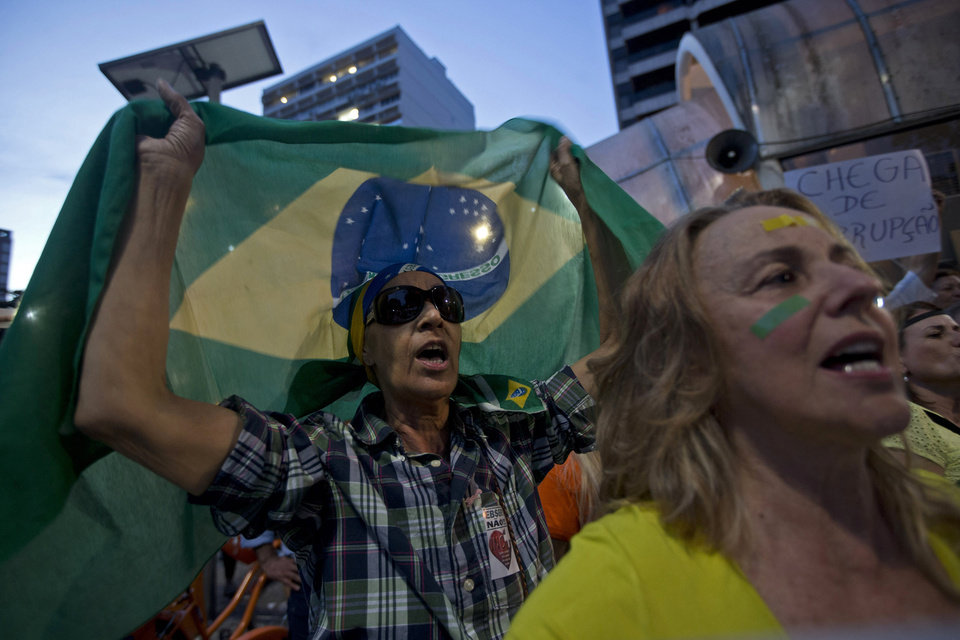 Photo - Residents of the Ipanema neighborhood shout during an anti-government protest in Rio de Janeiro, Brazil, Friday, June 21, 2013. Demonstrations began as an outcry against a 10-cent hike in bus and subway fares in Brazil's largest cities, but have continued even after announcements that the increases would be rescinded. Protesters have expressed frustration with corruption and what they say are high taxes and poor public services. They've demanded everything from education reforms to free bus fares while denouncing the billions of public dollars spent on stadiums before the World Cup and the Olympics. (AP Photo/Silvia Izquierdo)