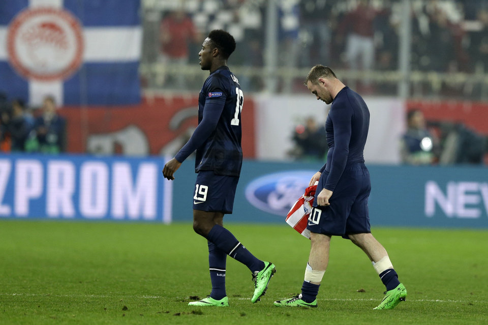 Photo - Manchester United's Wayne Rooney, right, and Danny Welbeck leave the pitch after Champions League, round of 16, first leg soccer match against Olympiakos at Georgios Karaiskakis stadium, in Piraeus port, near Athens, on Tuesday, Feb. 25, 2014. Olympiakos won 2-0. (AP Photo/Thanassis Stavrakis)