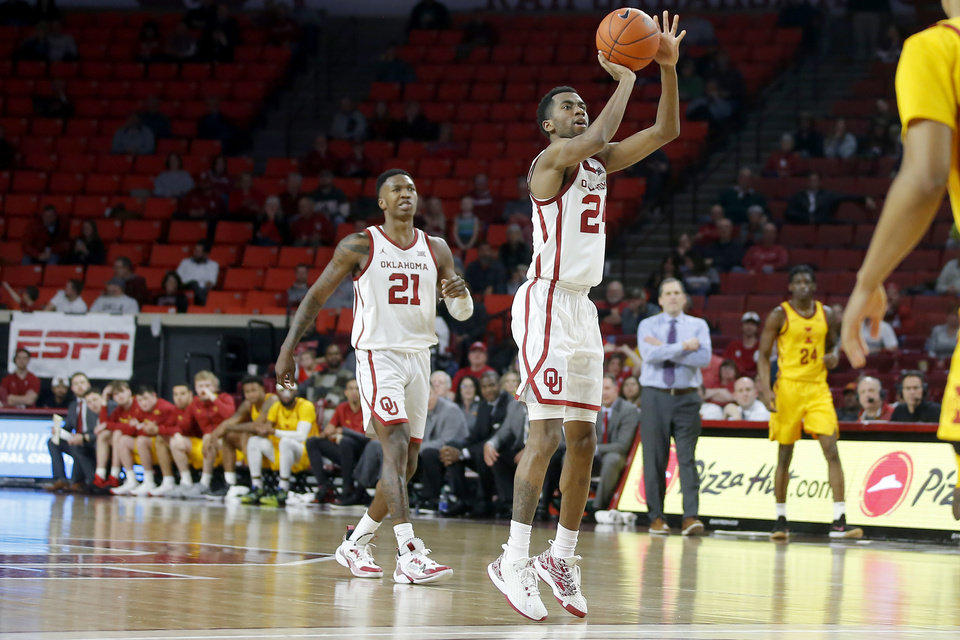 Photo - Oklahoma's Jamal Bieniemy (24) makes a 3-pointer in front of Kristian Doolittle (21) 2during an NCAA basketball game between the University of Oklahoma Sooners (OU) and the Iowa State Cyclones at the Lloyd Noble Center in Norman, Okla., Wednesday, Feb. 12, 2020. [Bryan Terry/The Oklahoman]
