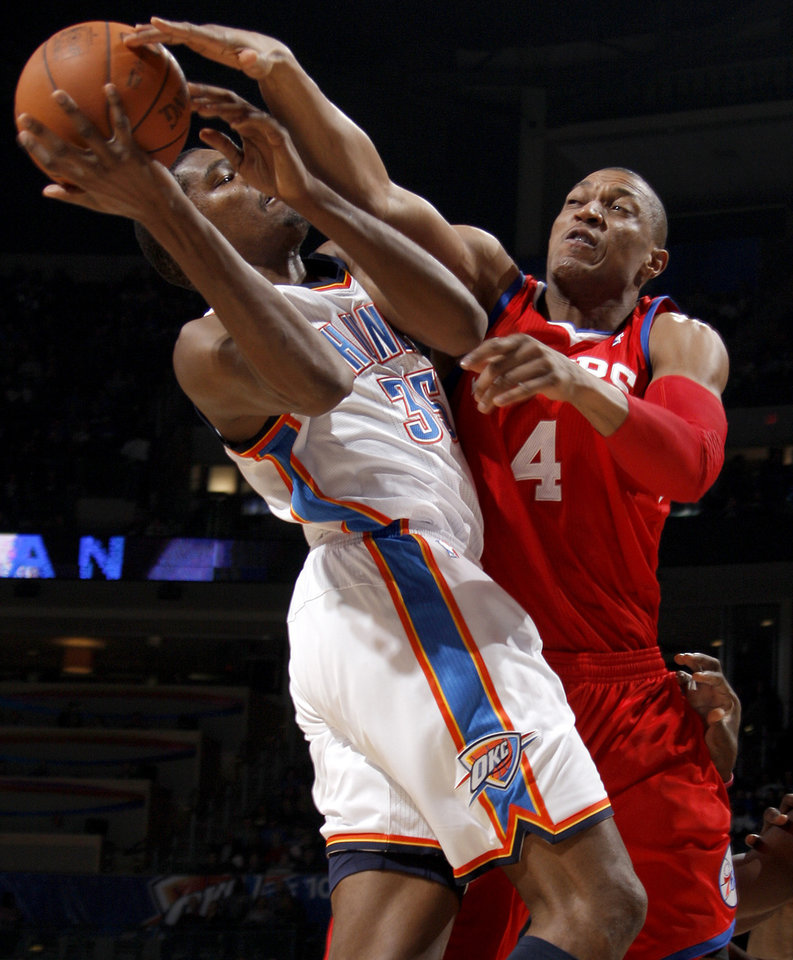 Photo - Oklahoma City's Kevin Durant is fouled by Philadelphia's Tony Battie as he makes a shot during the NBA basketball game between the Oklahoma City Thunder and the Philadelphia 76ers at the Oklahoma City Arena on Wednesday, Nov. 10, 2010.   Photo by Bryan Terry, The Oklahoman