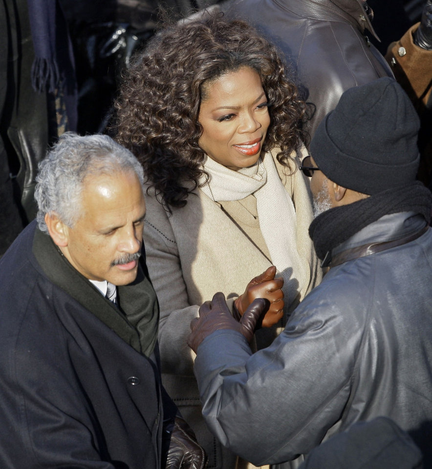 Photo - Oprah Winfrey, center, is joined by companion Steadman Graham as she arrives for the inauguration of Barack Obama and Joe Biden at the U.S. Capitol in Washington, Tuesday, Jan. 20, 2009.  (AP Photo/Elise Amendola)