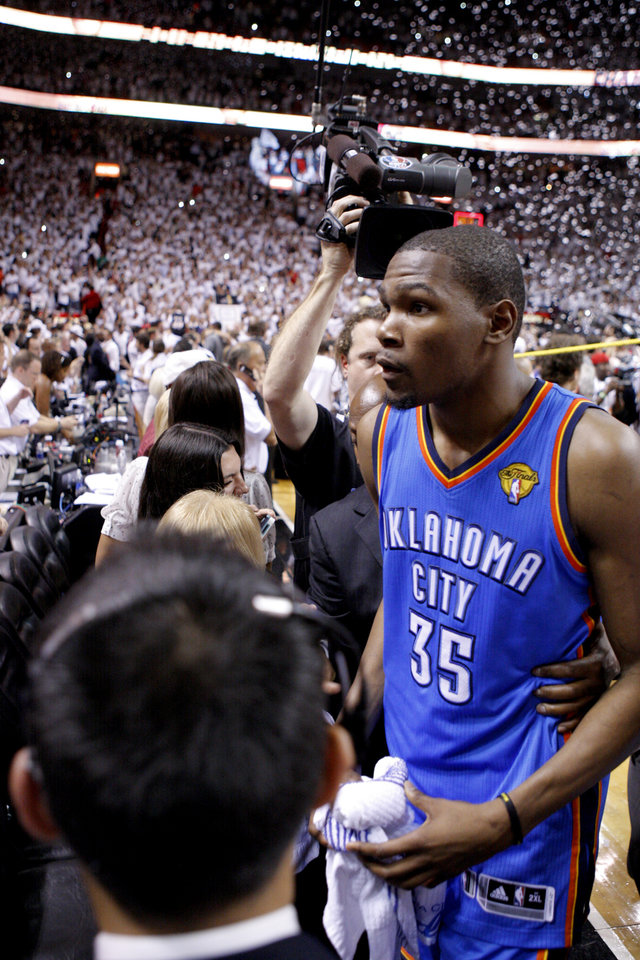 Photo - Oklahoma City's Kevin Durant (35) walks off the court after Game 5 of the NBA Finals between the Oklahoma City Thunder and the Miami Heat at American Airlines Arena, Thursday, June 21, 2012. Oklahoma City lost 121-106. Photo by Bryan Terry, The Oklahoman