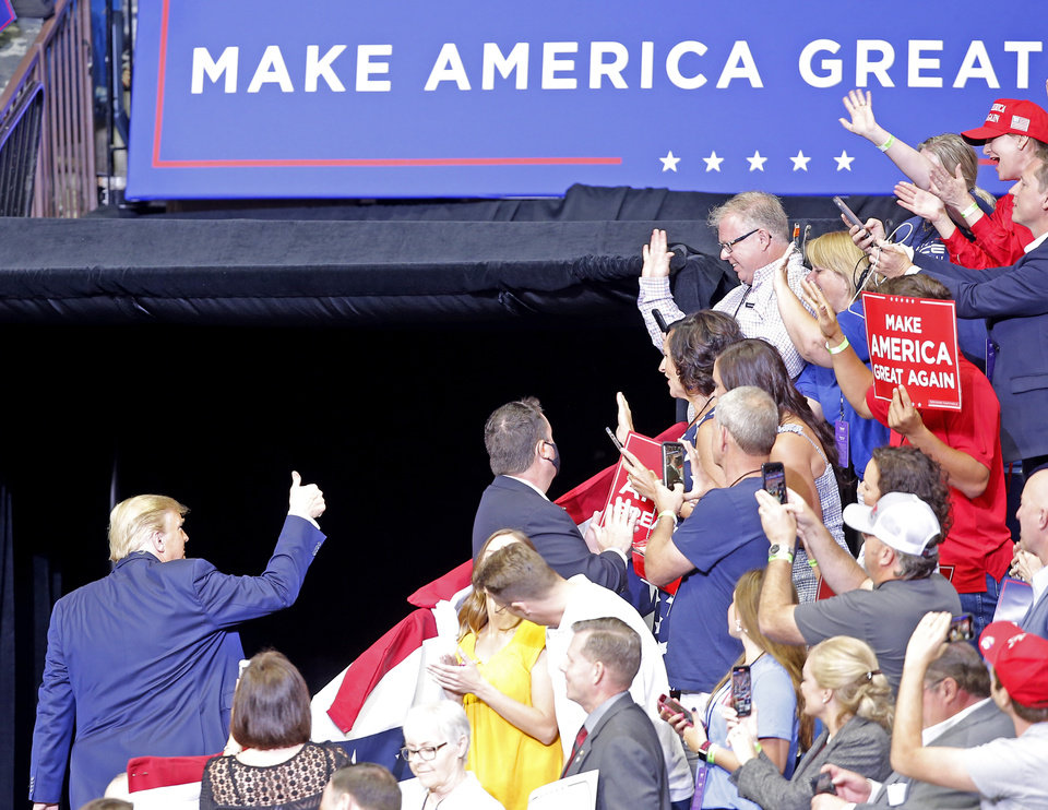 Photo - President Donald Trump leaves the arena following his speech during a rally at the BOK Center in Tulsa, Okla., Saturday, June 20, 2020. [Sarah Phipps/The Oklahoman]