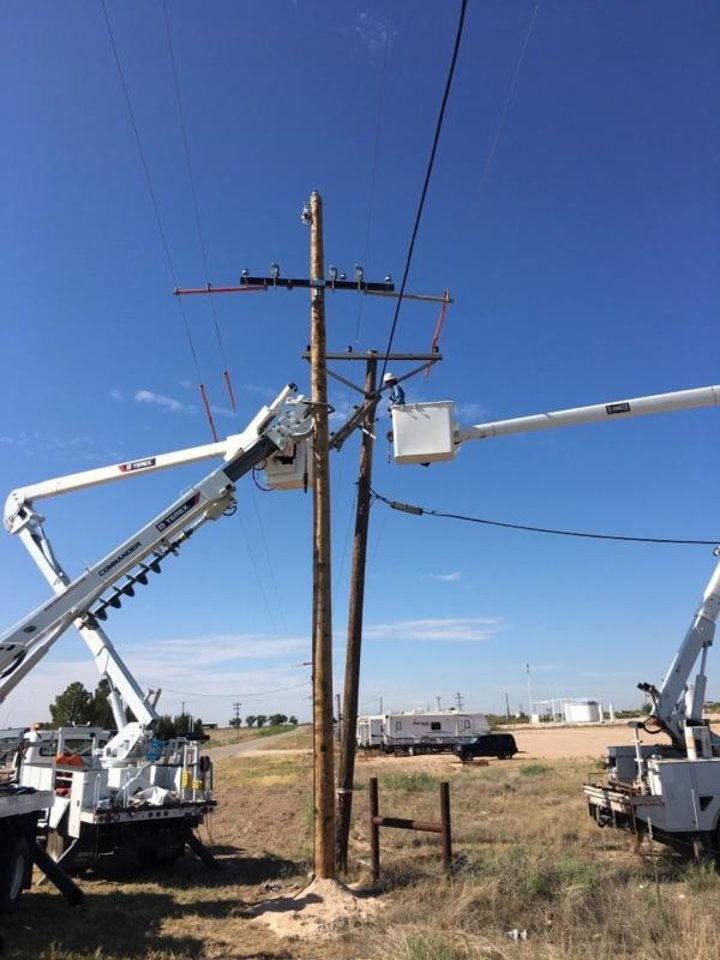 Photo -  Crews from Mammoth Energy Services Inc. subsidiary Cobra Acquisitions LLC repair power lines in west Texas. [Photo Provided]