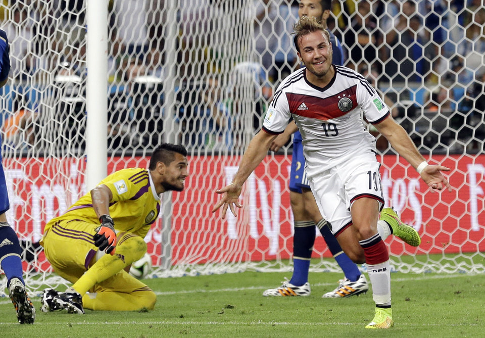 Photo - Germany's Mario Goetze celebrates after scoring the opening goal during the World Cup final soccer match between Germany and Argentina at the Maracana Stadium in Rio de Janeiro, Brazil, Sunday, July 13, 2014. Germany won 1-0 to win the World Cup. (AP Photo/Victor R. Caivano)