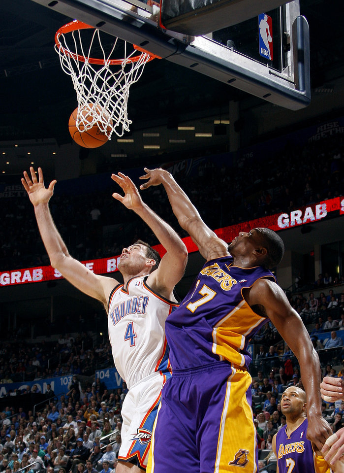 Photo - Oklahoma City's Nick Collison (4) and Lakers' Andrew Bynum (17) fight for a rebound during the NBA basketball game between the Oklahoma City Thunder and the Los Angeles Lakers, Sunday, Feb. 27, 2011, at the Oklahoma City Arena.Photo by Sarah Phipps, The Oklahoman