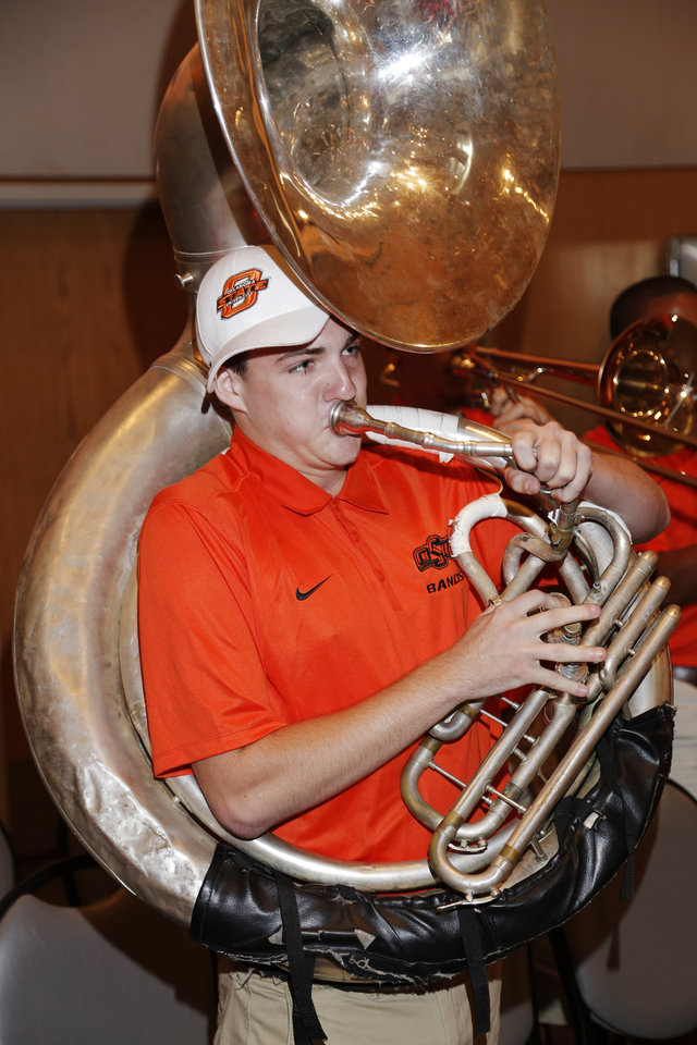 Photo - OSU tuba player Hunter Hutchens plays the fight song during the OSU Cowboy Caravan at the National Cowboy and Western Heritage Museum Tuesday, August 5, 2014. Photo by Doug Hoke, The Oklahoman