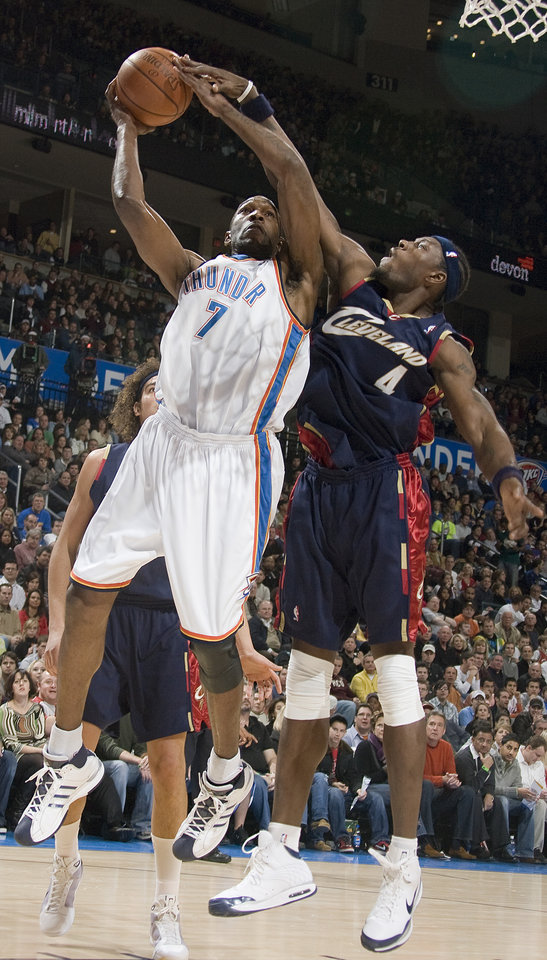 Oklahoma City's Joe Smith (7) and Cleveland's Ben Wallace (4)  fight for a rebound during the NBA game between the Oklahoma City Thunder and Cleveland Cavaliers, Sunday, Dec. 21, 2008, at the Ford Center in Oklahoma City. PHOTO BY SARAH PHIPPS, THE OKLAHOMAN