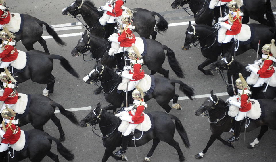 Photo - Members of the Household Cavalry mounted regiment travel along the Processional Route to Buckingham Palace, London, Friday April 29, 2011. (AP Photo/Damien Meyer, Pool)  ORG XMIT: RWDJ124