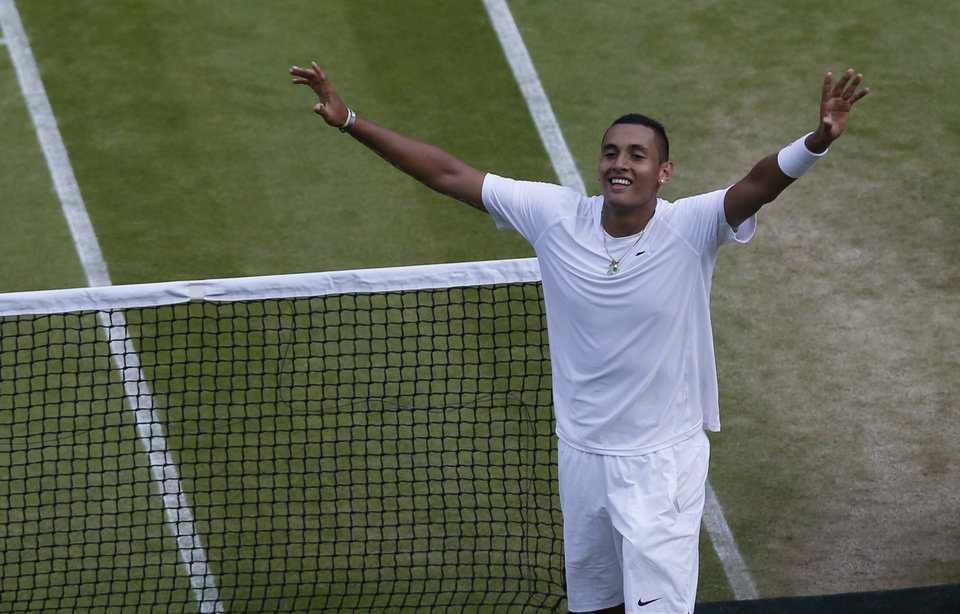 Photo - Nick Kyrgios of Australia celebrates defeating Rafael Nadal of Spain in their men's singles match on Centre Court at the All England Lawn Tennis Championships in Wimbledon, London, Tuesday July 1, 2014. (AP Photo/Sang Tan)