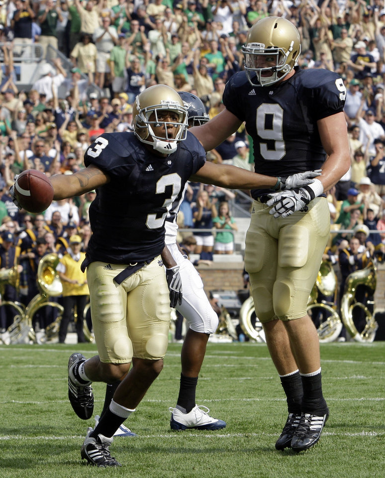 ** CORRECTS DATE **  Notre Dame wide receiver Michael Floyd, left, and tight end Kyle Rudolph celebrates a second quarter touchdown against Nevada during an NCAA college football game in South Bend, Ind., Saturday, Sept. 5, 2009. (AP Photo/Michael Conroy) ORG XMIT: INMC102