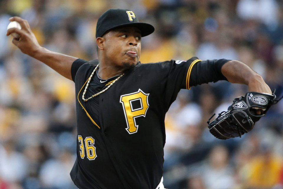 Photo - Pittsburgh Pirates starting pitcher Edinson Volquez (36) delivers during the first inning of a baseball game against the Miami Marlins in Pittsburgh Thursday, Aug. 7, 2014. (AP Photo/Gene J. Puskar)