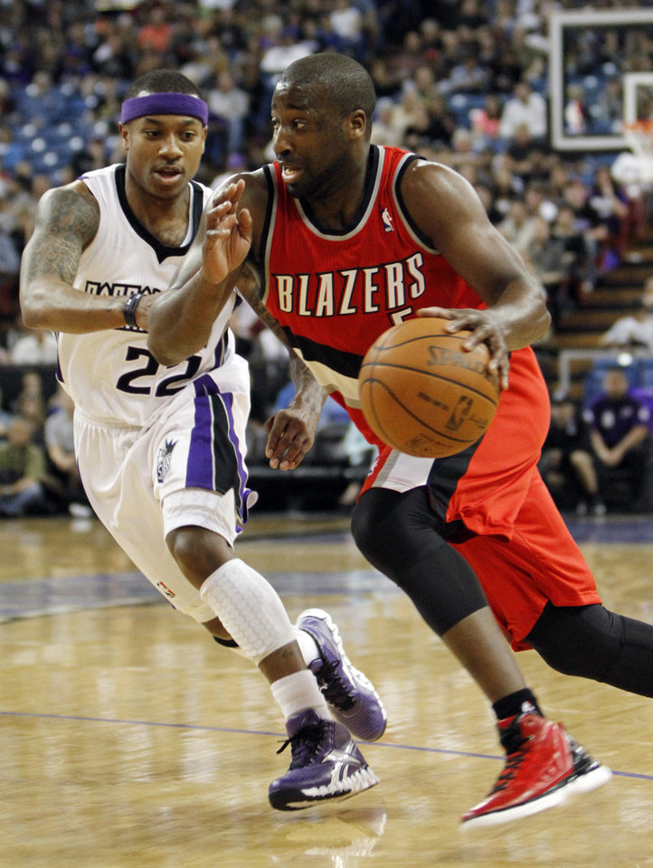 Portland Trail Blazers guard Raymond Felton, right, drives against Sacramento Kings guard Isaiah Thomas during the first quarter of an NBA basketball game in Sacramento, Calif., Sunday, April 15, 2012. (AP Photo/Rich Pedroncelli)
