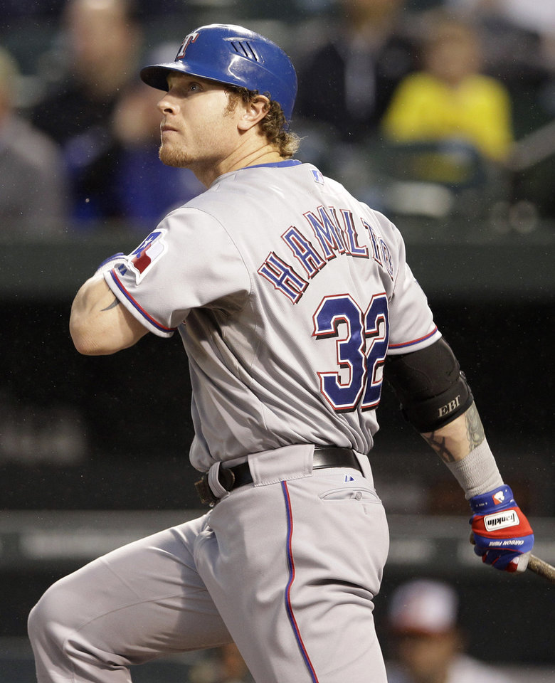 Texas Rangers' Josh Hamilton watches his two-run home run in the third inning of a baseball game against the Baltimore Orioles in Baltimore, Tuesday, May 8, 2012. (AP Photo/Patrick Semansky)