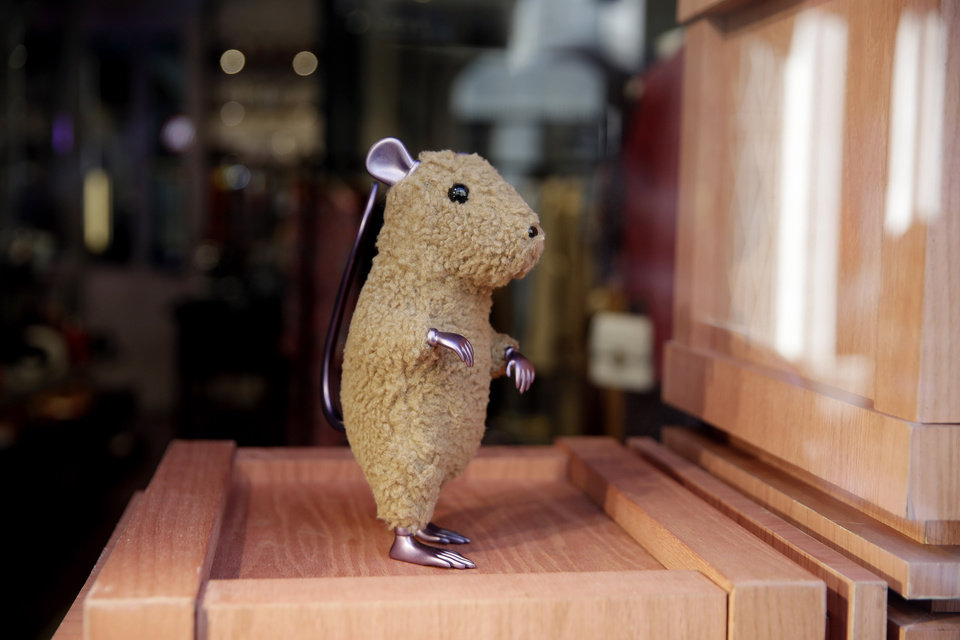 Photo -  A rat figurine is displayed in a shop at Montenapoleone shopping district, in Milan, Italy, Tuesday, Feb. 4, 2020.  China's virus outbreak is giving global business a chill. In Milan's luxury Montenapoleone shopping district, dozens of luxury brands decked out their windows for Chinese New Year. But wealthy Chinese shoppers, who are responsible for about one-third of all luxury purchases globally, have failed to arrive in their usual numbers. (AP Photo/Luca Bruno)