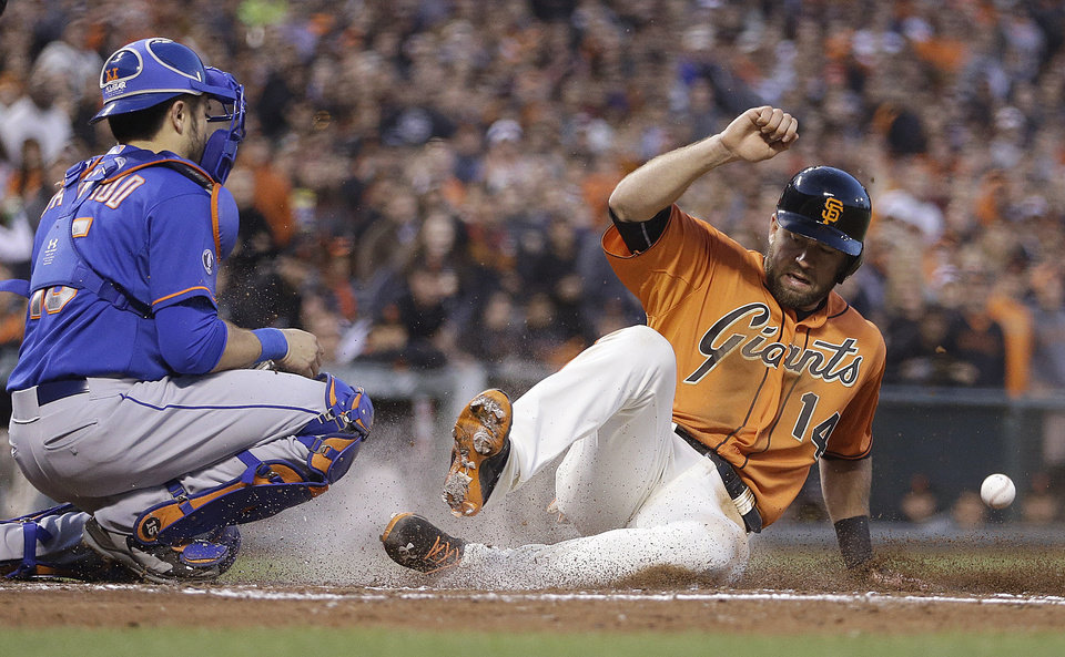 Photo - San Francisco Giants' Brandon Hicks, right, slides ahead of the ball to score past New York Mets catcher Travis d'Arnaud in the fifth inning of a baseball game Friday, June 6, 2014, in San Francisco. Hicks scored on a sacrifice fly by Brandon Crawford. (AP Photo/Ben Margot)