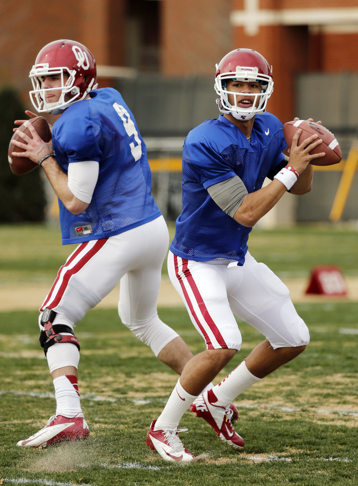 Photo - COLLEGE FOOTBALL: Quarterbacks Trevor Knight (9) and Kendal Thompson (1) throw during Sooner spring football drills at University of Oklahoma (OU) on Tuesday, March 12, 2013 in Norman, Okla.  Photo by Steve Sisney, The Oklahoman
